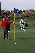 Foursome golfing on fairway, Canyon hole #1, Westin La Paloma. ©1993Edward McCain. All rights reserve. McCain Photography, McCain Creative.