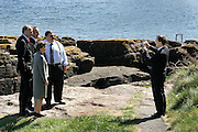 15/5/2005.The Minister for the Environment, Heritage & Local Government, Mr Martin Cullen TD (right) pictured in Dunmore East County Waterford  taking a photograph of some of the  European Ministers for the Environment..Pictured in the group from left are Jurgen Trittin from Germany, Miklos Persanyi from Hungry,Lena Sommestad from Sweden and George Pullicino from Malta.The ministers were in waterford for the Informal Council of the EU Environment Ministers which was held at Waterford Institute of Technology at the weekend..Picture Dylan Vaughan.