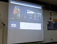 Carol White of Cedar Rapids asks a question to President Barack Obama during the live video chat at the Democratic Party Caucus at Washington High School, 2205 Forest Drive SE, in Cedar Rapids, on Tuesday evening, January 3, 2012. (Stephen Mally/Freelance)