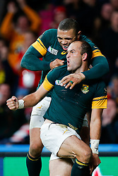 South Africa Scrum-Half Fourie du Preez (capt) celebrates with Winger Bryan Habana after scoring a try to win the match - Mandatory byline: Rogan Thomson/JMP - 07966 386802 - 17/10/2015 - RUGBY UNION - Twickenham Stadium - London, England - South Africa v Wales - Rugby World Cup 2015 Quarter Finals.