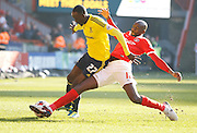 Charlton Athletic midfielder Alou Diarra (12) gets a tackle in to stop the attack from Middlesbrough FC midfielder Albert Adomah (27) during the Sky Bet Championship match between Charlton Athletic and Middlesbrough at The Valley, London, England on 13 March 2016. Photo by Andy Walter.