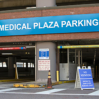 A no parking and no visitation sign is placed at an Advent Health Hospital Campus parking garage on Saturday, March 28, 2020 in Orlando, Florida. (Alex Menendez via AP)
