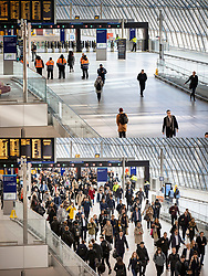 © Licensed to London News Pictures. 23/03/2020. London, UK. In this combined image the effect of the Coronavirus on passenger numbers can be seen at 08:30am on the 11th March (lower image) and today at the same time (top image) at London's Waterloo Station. Photo credit: Rob Pinney/Peter Macdiarmid/LNP