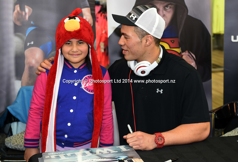 6yr old Isabella Arama from Manukau poses for a picture with Boxer Joseph Parker during a signing session at Rebel Sport Manukau for sponsor Under Armour ahead of the Parker v Minto Hydr8 Zero Heavyweight Explosion fight scheduled for 5 July 2014. Auckland. Saturday 28 June 2014. Photo: Andrew Cornaga/www.photosport.co.nz
