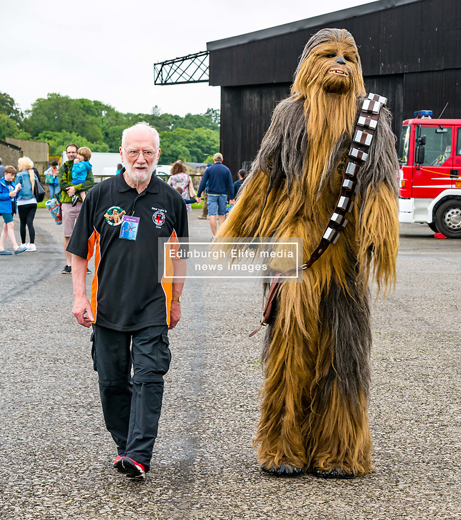 Pictured: Scotland's National Airshow, East Fortune, East Lothian, Scotland, United Kingdom, 27 July 2019 . A packed programme of aircraft old and new planned to take to the skies for the aerial display was marred by poor weather at airfields around the country which meant that many of the promised flights were unable to perform. Chewbacca makes an appearance to entertain the crowd. <br /> Sally Anderson   EdinburghElitemedia.co.uk