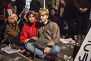 UNITED KINGDOM, London: 02 December 2015 A young couple sit in shock at the result of the decision to go ahead and bomb Syria after a historic Commons vote. Thousands of people gathered in Parliament Square this evening as part of a Stop The War campaign. Protesters have gathered outside Parliament for a second night as they await the result of a vote on UK air strikes in Syria. <br /> Rick Findler / Story Picture Agency
