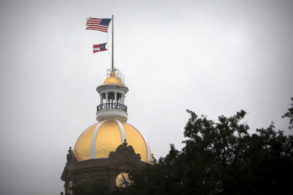 Wind from Hurricane Irma whip the flags on City Hall, Monday, Sept., 11, 2017, in Savannah, Ga. (AP Photo/Stephen B. Morton)