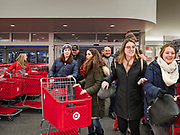 "28 NOVEMBER 2019 - ANKENY, IOWA: Shoppers rush into the Target store in Ankeny, Iowa, just after it opened. ""Black Friday"" is the unofficial start of the Christmas holiday shopping season and has traditionally thought to be one of the busiest shopping days of the year. Brick and mortar retailers, like Target, are facing increased pressure from online retailers this year. Many retailers have started opening on Thanksgiving Day. Target stores across the country opened at 5PM on Thanksgiving to attract shoppers with early ""Black Friday"" specials.     PHOTO BY JACK KURTZ"