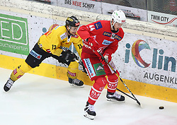 14.04.2019, Albert Schultz Halle, Wien, AUT, EBEL, Vienna Capitals vs EC KAC, Finale, 1. Spiel, im Bild v.l. Emil Romig (spusu Vienna Capitals) und Adam Comrie (EC KAC) // during the Erste Bank Icehockey 1st final match between Vienna Capitals and EC KAC at the Albert Schultz Halle in Wien, Austria on 2019/04/14. EXPA Pictures © 2019, PhotoCredit: EXPA/ Thomas Haumer