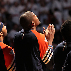 Jun 17, 2012; Miam, FL, USA; Oklahoma City Thunder small forward Kevin Durant (center) listens to the National Anthem before game three in the 2012 NBA Finals against the Miami Heat at the American Airlines Arena. Mandatory Credit: Derick E. Hingle-US PRESSWIRE