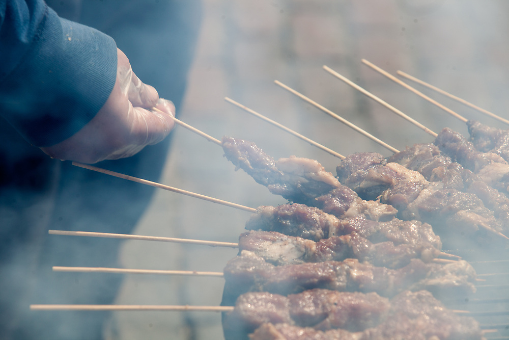 The Indonesian Student Association makes lamb satay on a grill on Court Street during the International Street Fair on Saturday, April 15, 2017. Photo by Kaitlin Owens