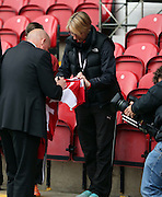 Mark Warburton signing autographs before the game with Boro during the Sky Bet Championship first leg play off match between Brentford and Middlesbrough at Griffin Park, London, England on 8 May 2015. Photo by Matthew Redman.