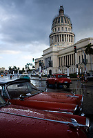 HAVANA, CUBA - CIRCA MARCH 2017: Old classic cars parked in front of the Havana Capitol.