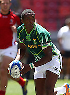 Sampie Mastriet of South Africa looks for support during the match between South Africa and Canada of the HSBC Sevens World Series Port Elizabeth Leg held at the Nelson Mandela Bay Stadium on 7th December 2013 in Port Elizabeth, South Africa. Photo by Shaun Roy/Sportzpics