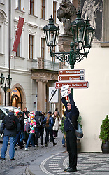 Prague, Czech Republic:  A free-lance guide looks for businss in Old Town Square.