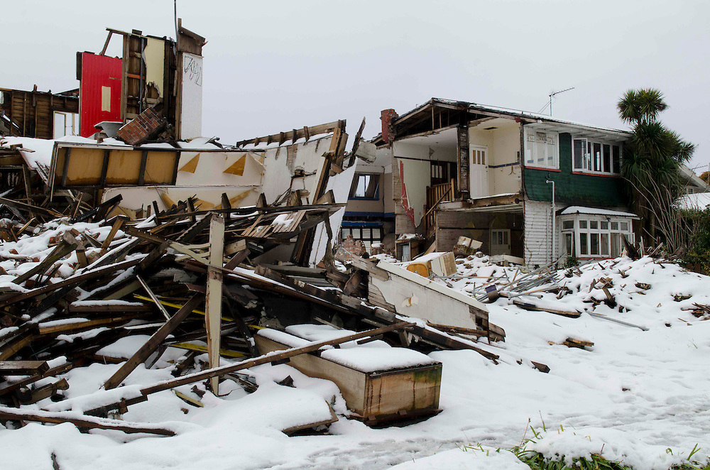 A cold bath of snow in the earth quake ruins of a residence, Peterborough Street, Christchurch, New Zealand, Monday, August 15, 2011. Credit: SNPA / David Alexander