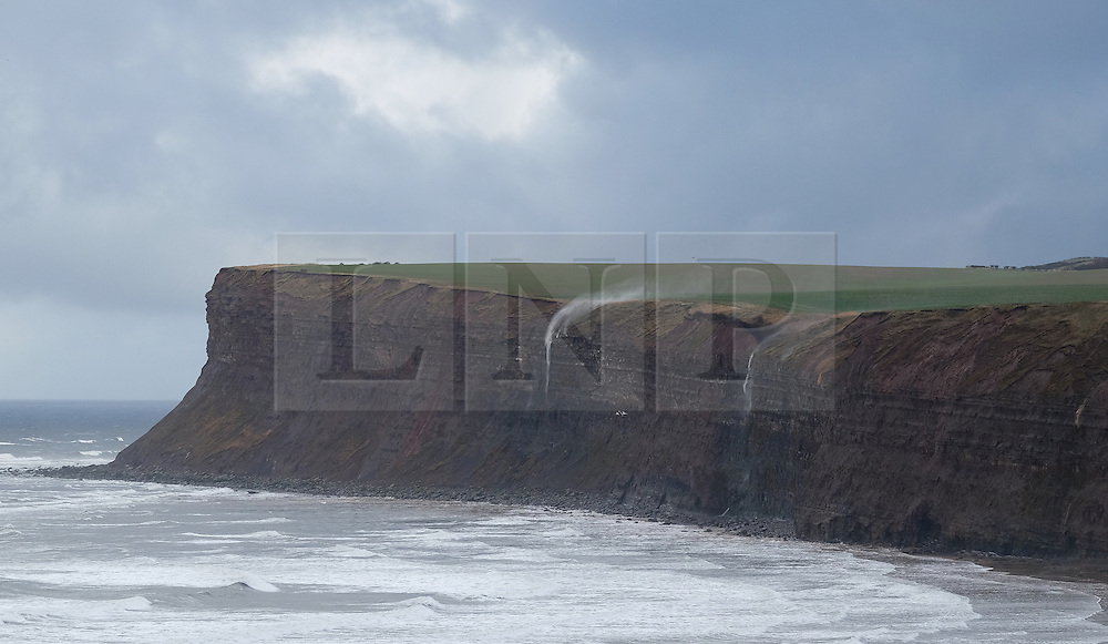 © Licensed to London News Pictures. <br /> 04/02/2015. <br /> <br /> Saltburn, United Kingdom<br /> <br /> Strong northerly winds blowing off the sea blow water back up the face of Huntcliff near Saltburn in Cleveland. Further bad weather has caused disruption in many parts of the country this week.<br /> <br /> Photo credit : Ian Forsyth/LNP