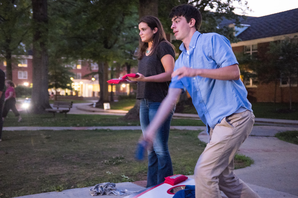 Addison Senter, a freshman majoring in Athletic Training from Hilliard, OH, and Robbie Harris, a freshman majoring in Astrophysics from Lancaster, OH, play cornhole during the Late Night on the Green on Wednesday, June 3, 2015.  Photo by Ohio University  /  Rob Hardin