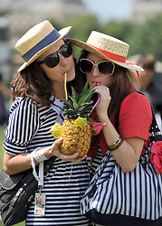 © licensed to London News Pictures. LONDON. UK.  01/07/11. Two girls enjoy a drink in the heat at the festival in Clapham Common. Jamie Oliver's The Big Feastival, is a three day event featuring food from some of the country's top chefs along with live music. The Big Feastival takes place on Clapham Common on the 1st, 2nd and 3rd July. All profits from the event will be shared between The Jamie Oliver Foundation and The Prince's Trust.  Mandatory Credit Stephen Simpson/LNP