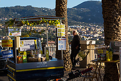 Sorrento, Italy, September 17 2017. A vendor sells limoncello and lemonade at a lay-by overlooking Sorrento, Italy. © Paul Davey