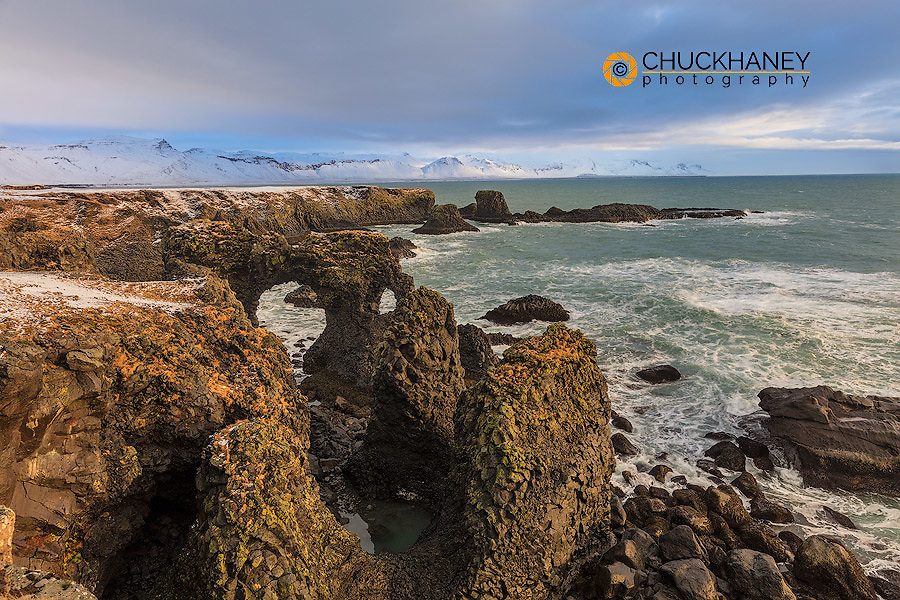 Arch Basalt sea cliffs on the North Atlantic ocean at Arnarstapi on the Snaefellsnes Peninsula in western Iceland