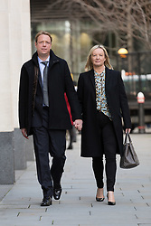 © Licensed to London News Pictures. 25/01/2018. London, UK. © Licensed to London News Pictures. 25/01/2018. LONDON, UK.  Gabby (Gabrielle) and Florian Kuehn arrive at the High Court, Rolls Building for an appeal hearing against the blanket no pet policy clause in the leasehold agreement issued by their property management company, Victory Place. The appeal follows a previous hearing at the Mayor's and City of London magistrates court held in February 2017 when Victory Place Management Company brought and won an action to evict the couples dog, Vinnie, a Maltese-Yorkshire terrier cross. The Kuehn's have appealed against the original judgement and are challenging the legality of blanket no pet policies in leasehold contracts. Victory Place Management Company have lodged a counter appeal. Photo credit: Vickie Flores/LNP. Photo credit: Vickie Flores/LNP