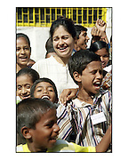Former Bollywood actress Ayesha Jhulka with children that attend her care centre in Versova, Mumbai, India.  Scan from 35mm colour negative. By Siddharth Siva