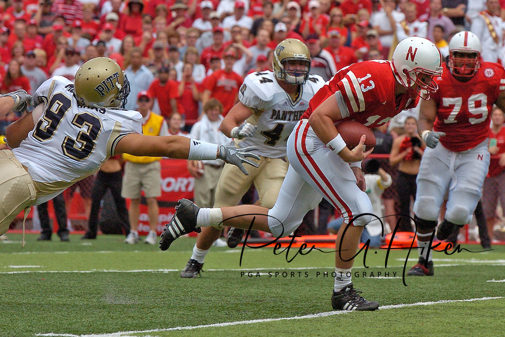 Nebraska quarterback Zac Taylor (13) rushes past Pittsburgh defender Gus Mustakas (93) for the Huskers lone touchdown, during the second quarter of the Huskers 7-6 win at Memorial Stadium in Lincoln, Nebraska on September 17, 2005.