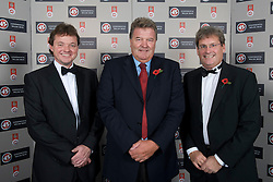 CARDIFF, WALES - Wednesday, November 11, 2009: Wales' manager John Toshack MBE (C) with SA Brains' Chairman John Rhys (R) and Richard Davies (Sales & Marketing Director) during the Football Association of Wales Player of the Year Awards hosted by Brains SA at the Cardiff City Stadium. (Pic by David Rawcliffe/Propaganda)