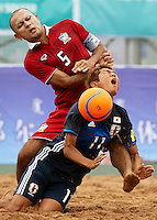 ORDOS, CHINA - AUGUST 23:  Takasuke Goto (R) of Japan is tackled by Pongsak Khongkaew of Thailand during the Continental Beach Soccer Tournament match between Japan and Thailand at Municipal Sports Center on August 23, 2016 in Ordos of Inner Mongolia Autonomous Region, China.  (Photo by Manuel Queimadelos Alonso/Getty Images)