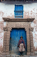 Moray, Peru - July 15, 2013: woman in front of ancient door in the peruvian Andes at Moray in Cuzco Peru on july 15, 2013