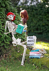 30 October 2015. New Orleans, Louisiana.<br /> The Skeleton Krewe mansion on St Charles Avenue at the corner of State Street draws crowds with its satirically spooky Halloween decorations. Dead Poets Society.<br /> Photo©; Charlie Varley/varleypix.com