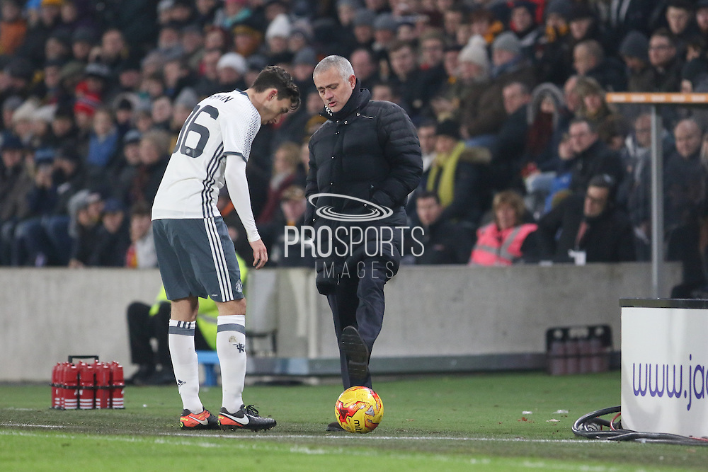 Jose Mourinho Manager of Manchester United Manager kicks the ball back to Matteo Darmian Defender of Manchester United during the EFL Cup semi final match 2 between Hull City and Manchester United at the KCOM Stadium, Kingston upon Hull, England on 26 January 2017. Photo by Phil Duncan.