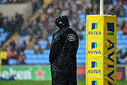 A Wasps substitute watches the game in the heavy rain from by the posts during the Aviva Premiership match between Wasps and London Irish at the Ricoh Arena, Coventry, England on 4 March 2018. Picture by Dennis Goodwin.