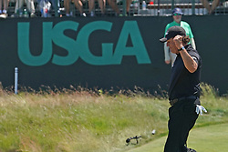 June 17, 2018 - Southampton, NY, USA - Phil Mickelson gives a fist pump after the 16th hole during the final round of the 2018 U.S. Open on Sunday, June 17, 2018 at Shinnecock Hills Country Club in Southampton, N.Y. (Credit Image: © Brian Ciancio/TNS via ZUMA Wire)