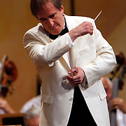 Highland Park, Illinois: Conductor James Conlon conducting the Chicago Symphony Orchestra, in Ravinia Friday, July 10, 2009. Conlon began his tenure as music director of  Ravinia Festival during the 2005 season. Ravinia, with its expansive lawn and pavilion is one of the most unique, respected and oldest music festival in North America.   Photography by Jose More..