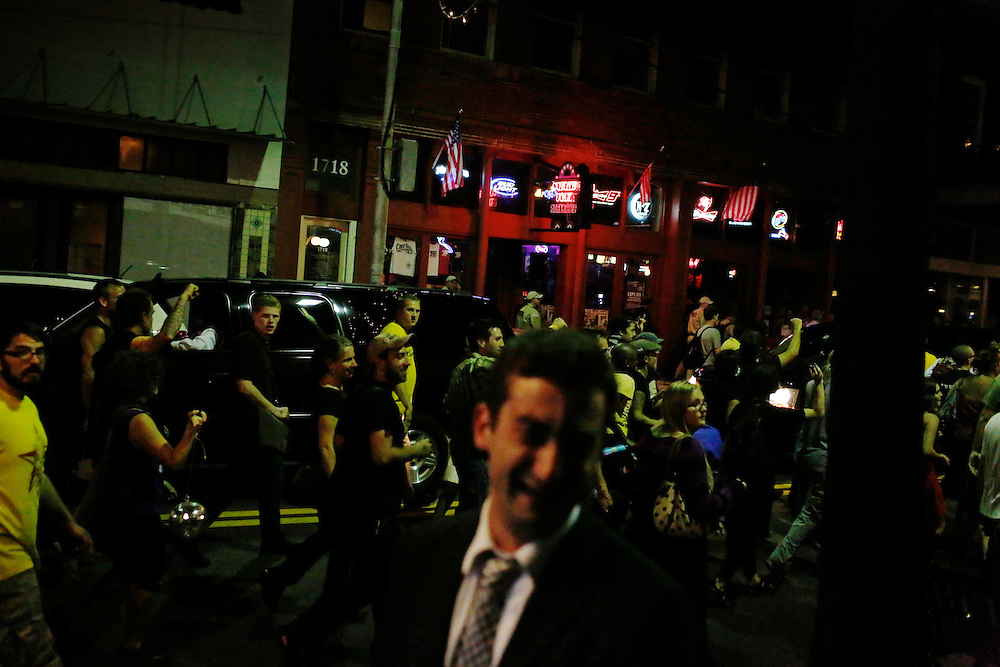 Anti-GOP demonstrators participate in a dance party flash mob through the streets of Ybor City during the 2012 Republican National Convention in Tampa, Fla.