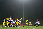 Spencerport's Special Teams unit blocks a kick during a game at Spencerport High School on Friday, October 17, 2014.