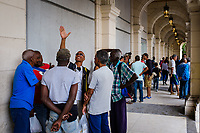 HAVANA, CUBA - CIRCA MARCH 2017:  Group of sports enthusiasts discussing in the streets of Havana.