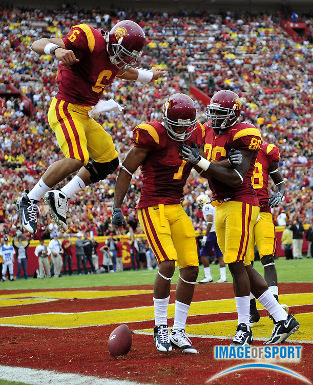 Nov 1, 2008; Los Angeles, CA, USA; Southern California Trojans receiver Patrick Turner (1), center, celebrates with quarterback Mark Sanchez (6), left, and tight end Anthony McCoy (86) after scoring on a 4-yard touchdown pass in the first quarter during 56-0 victory over the Washington Huskies at the Los Angeles Memorial Coliseum.