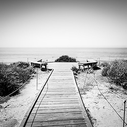 Crystal Cove overlook black and white picture in Crystal Cove State Park with seating area benches. Crystal Cove State Park is located along the Pacific Ocean in Laguna Beach, Orange County, California. Image Copyright © Paul Velgos All Rights Reserved.