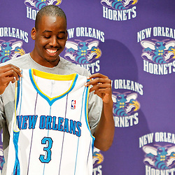 December 17, 2011; New Orleans, LA, USA; New Orleans Hornets small forward Al-Farouq Aminu (3) smiles as he holds up his jesey at a press conference to introduce players acquired from the Los Angeles Clippers in the Chris Paul trade prior to team scrimmage at the New Orleans Arena.   Mandatory Credit: Derick E. Hingle-US PRESSWIRE