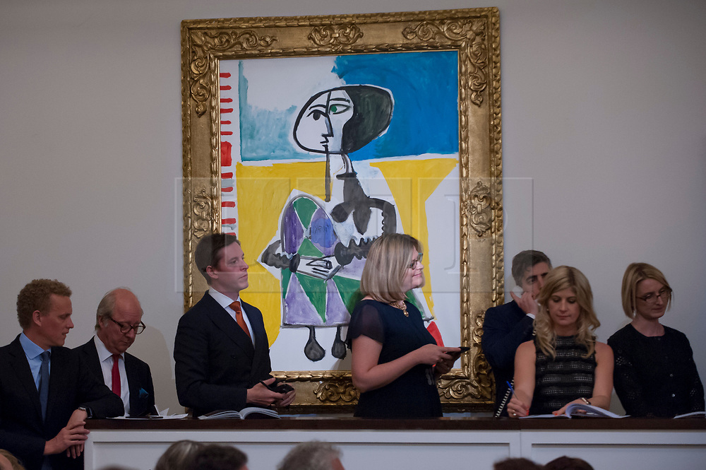 "© Licensed to London News Pictures. 21/06/2017. London, UK. ""Femme accroupie"", 1954, by Pablo Picasso sold for a hammer price of GBP6.4m (estimate GBP6.5-8.5m) at Sotheby's Impressionist and Modern Art evening sale in New Bond Street. Photo credit : Stephen Chung/LNP"