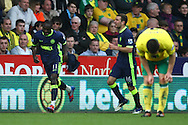 Picture by Paul Chesterton/Focus Images Ltd.  07904 640267.11/03/12.Victor Moses of Wigan takes the ball round John Ruddy of Norwich to score his side's equalising goal and celebrates during the Barclays Premier League match at Carrow Road Stadium, Norwich.