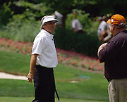 Jun 26, 2006; Gaylord MI; Craig Stadler (right) jokes with Fred Couples (left) after couples wins a skin on the 6th hole during the ING Par-3 Shootout at Treetops Resort in Gaylord Michigan.
