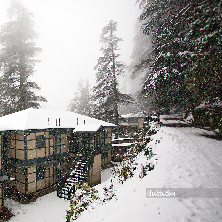 An old house at Jakhoo, Shimla covered with a white sheet of fresh snow during the first snowfall of the season.