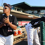 Reynaldo Rodriguez, (left) and Corey Wimberly, New Britain Rock Cats, prepare before the New Britain Rock Cats Vs Binghamton Mets Minor League Baseball game at New Britain Stadium, New Britain, Connecticut, USA. 2nd July 2014. Photo Tim Clayton