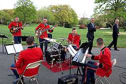 """President Barack Obama and Chief of Staff Denis McDonough listen to the """"Jazz Combo of 'The President's Own' U.S. Marine Band"""" who were playing for the President's Medicare Sustainable Growth Rate reception in the Rose Garden of the White House, April 21, 2015. (Official White House Photo by Pete Souza)<br /> <br /> This official White House photograph is being made available only for publication by news organizations and/or for personal use printing by the subject(s) of the photograph. The photograph may not be manipulated in any way and may not be used in commercial or political materials, advertisements, emails, products, promotions that in any way suggests approval or endorsement of the President, the First Family, or the White House."""