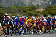 Athletes compete in stage five of the annual Vuelta al Tachira cycling race in Merida, Venezuela on Wednesday, Jan. 9, 2008. Local and international teams will ride over 1580 kilometers and climb a 1500 meter altitude differential throughout the competition. The grueling, 13-stage race through the Andes mountains is hailed as the premier cycling event in South America.  ....