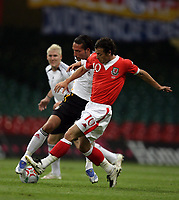 Photo: Rich Eaton.<br /> <br /> Wales v Germany. UEFA European Championships Qualifying. 08/09/2007. Germany's Kevin Kuranyi (L) is tackled by Wales Simon Davies (R).